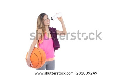 Young woman drinking water from a bottle after exercising against a white background - stock photo