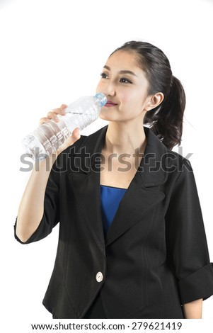 young woman drinking water white background, Isolated. - stock photo