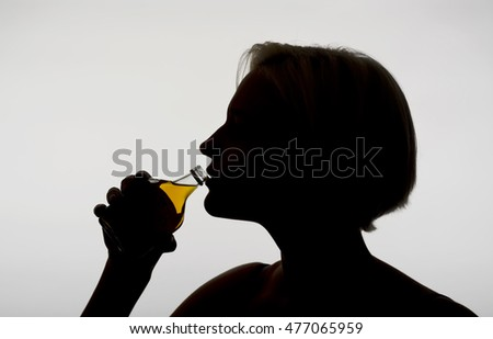 young woman drinking whiskey bottle