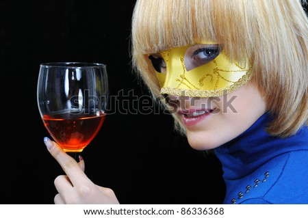 young woman drinking wine on black background - stock photo