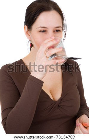 young woman drinks clear mineral water from glass - stock photo