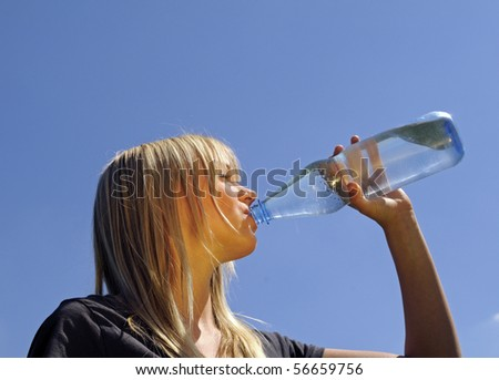 young woman drinks water - stock photo