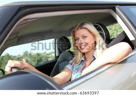 Young woman driving new car
