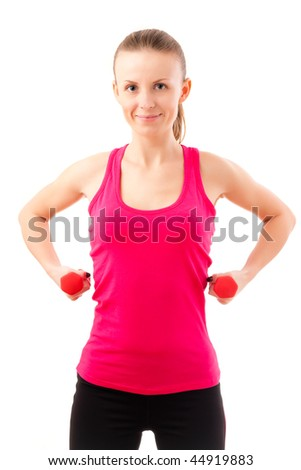 Young woman during fitness with dumbbells