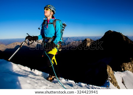 Young woman during mountain ascent - stock photo
