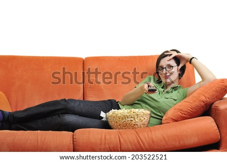 young woman eat popcorn, watching movies and eat popcorn at modern home living room  isolated on white background - stock photo