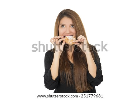 Young woman eating a delicious chocolate croissant against a white background - stock photo
