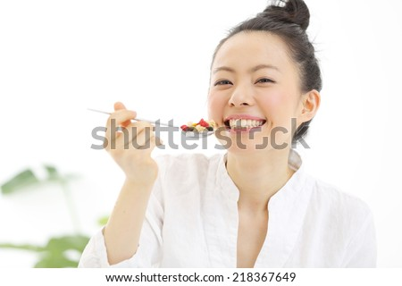 young woman eating cereals - stock photo