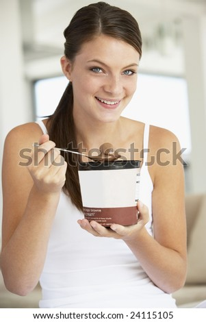 Young Woman Eating Chocolate Ice-Cream