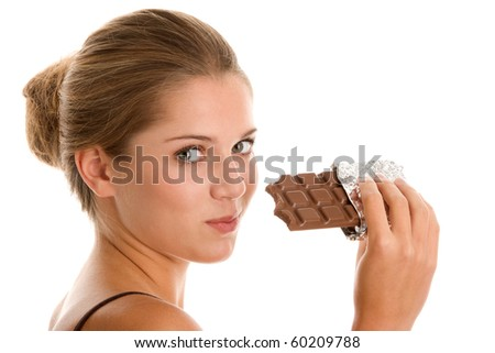 Young woman eating chocolate isolated on white background