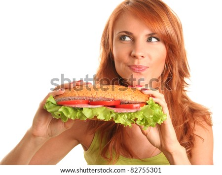 young woman eating fast food - stock photo