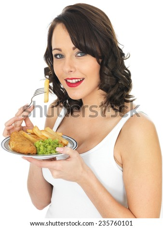 Young Woman Eating Fish and Chips with Mushy Peas - stock photo