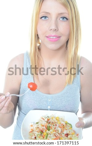 Young woman eating fresh salad isolated