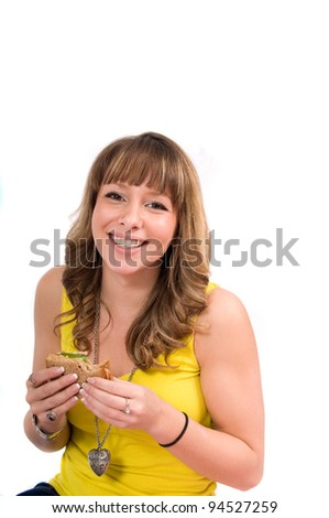 Young woman eating picnic lunch