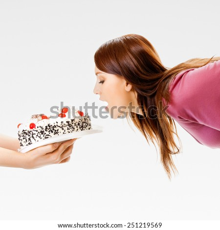 Young woman eating pie - stock photo