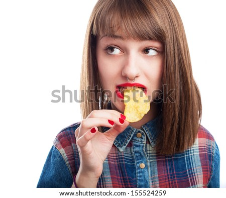 young woman eating potato chips on white background - stock photo