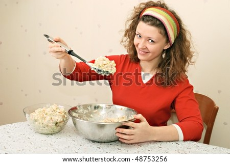 young woman eating salad with greediness