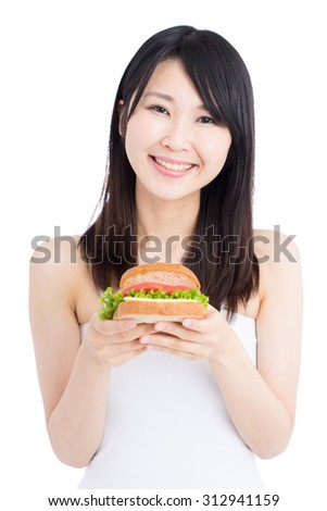 young woman eating sandwich isolated on white background