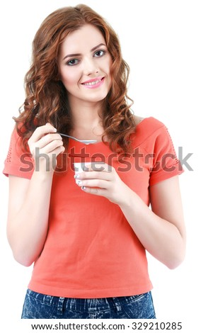 Young woman eating yogurt as breakfast or snack