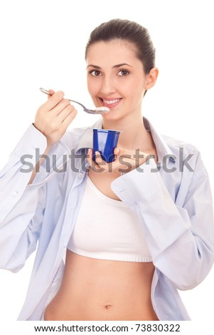 young woman eating yogurt, smiling, isolated on white - stock photo