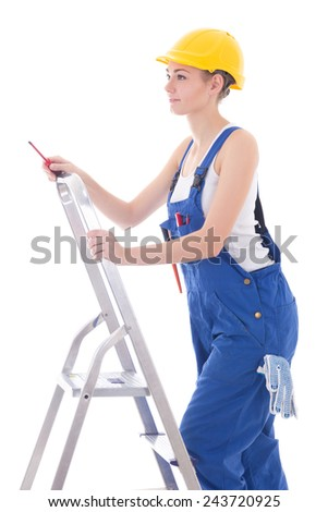 young woman electrician in workwear with screwdriver on ladder isolated on white background - stock photo