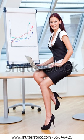 Young woman employed in business and office work - stock photo