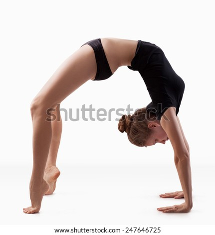 Young woman engaged in yoga on the floor