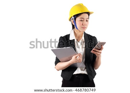 Young woman engineer holding digital tablet and using mobile phone isolated on white background