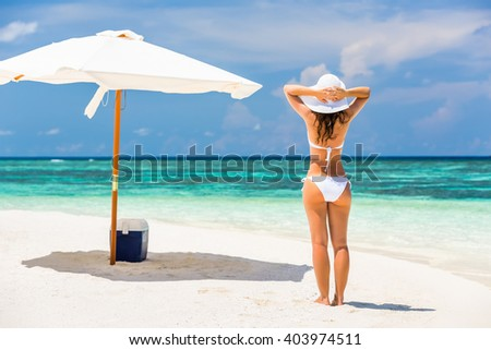 Young woman enjoing sun on the beach - stock photo
