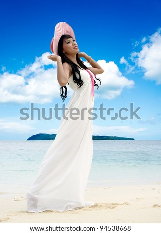 Young woman enjoy her vacation at beach