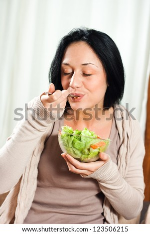 Young woman enjoy in salad,Healthy meal - stock photo
