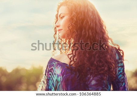 young woman enjoy in sunlight summer day small amount of grain added - stock photo