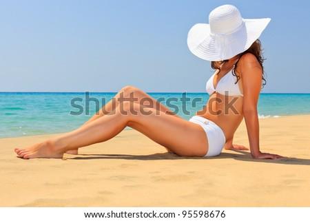 Young woman enjoy sun on the beach - stock photo