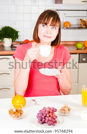 young woman enjoying a cup of coffee - stock photo