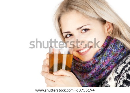 young woman enjoying a cup of tea isolated on white