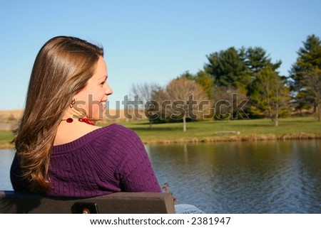 Young woman enjoying a fall day