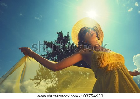 Young woman enjoying a summer day