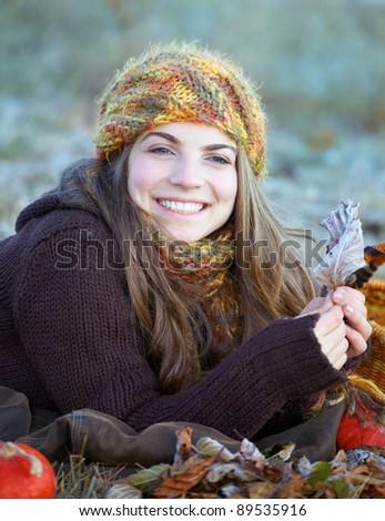 Young woman enjoying an autumn morning outdoor. - stock photo