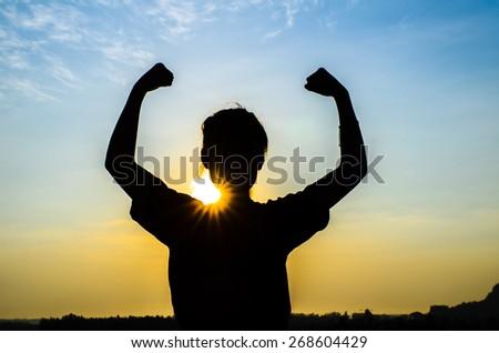 Young woman enjoying beautiful sun rise. - stock photo