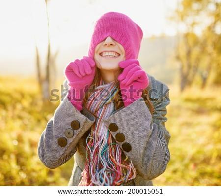 Young woman enjoying fall season. Autumn outdoor portrait. - stock photo