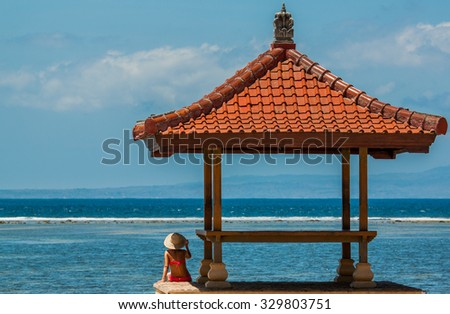 Young woman enjoying her summer holiday on Sanur beach in Bali, Indonesia - stock photo