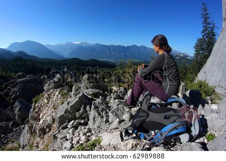 Young woman enjoying mountain panorama in the Alps - stock photo