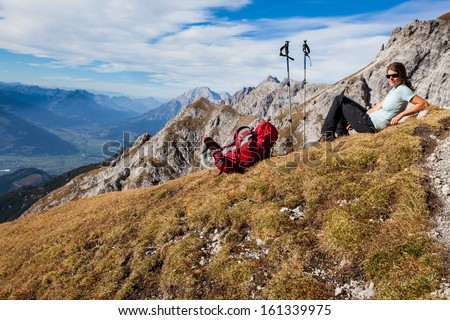 Young woman enjoying mountain scenery - stock photo