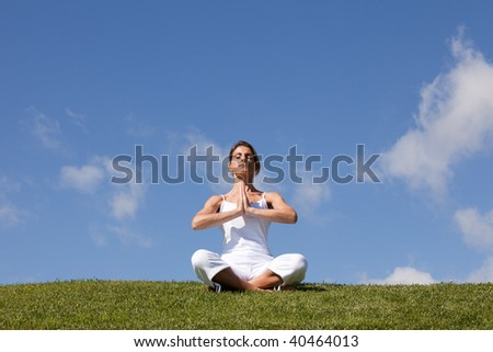 young woman enjoying nature in a yoga pose