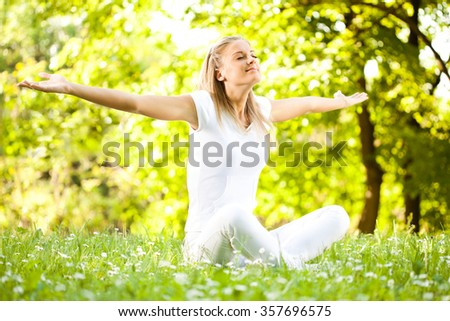 Young woman enjoying nature in park. - stock photo