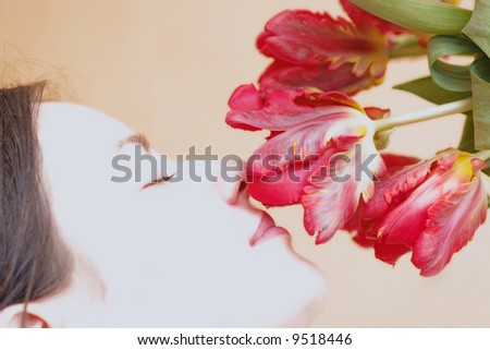 Young Woman Enjoying Red Tulips - stock photo