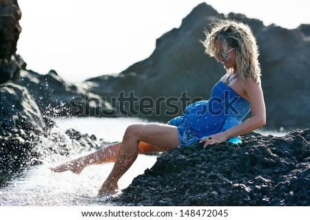 young woman enjoying  summer day on the beach - stock photo