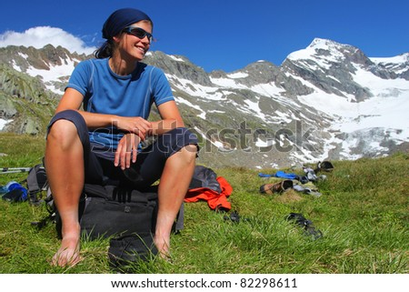Young woman enjoying the Austrian Alps - stock photo