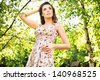 Young woman enjoying the fresh air in green forest. - stock photo