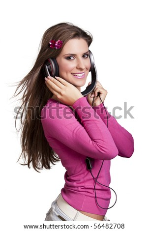 young woman enjoying the music in colorful clothes - stock photo